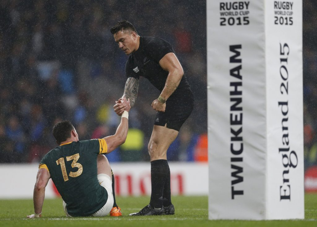 Jesse Kriel of South Africa is comforted by Sonny Bill Williams of New Zealand after New Zealand won their Rugby World Cup Semi-Final match against South Africa at Twickenham in London